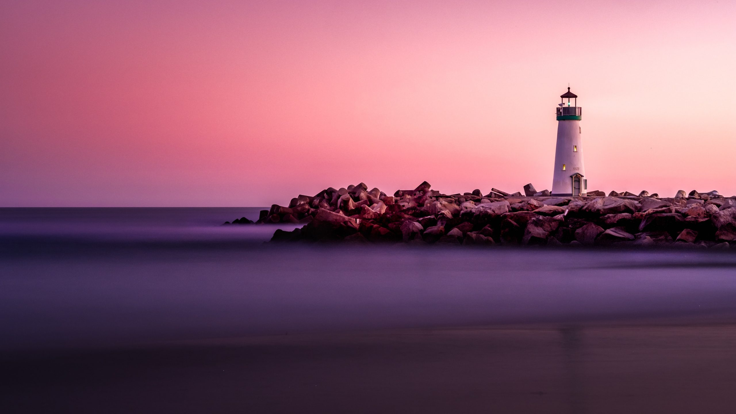 Lighthouse with a pink sky